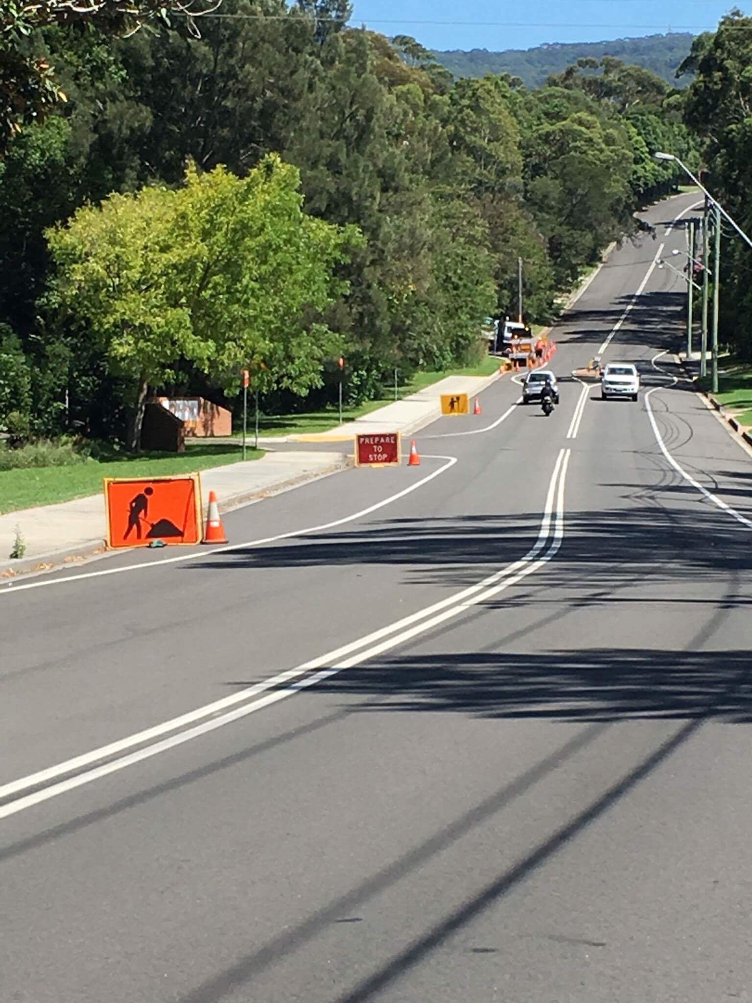TCMAP controlling traffic during shoulder works on O'Brien's rd, Figtree