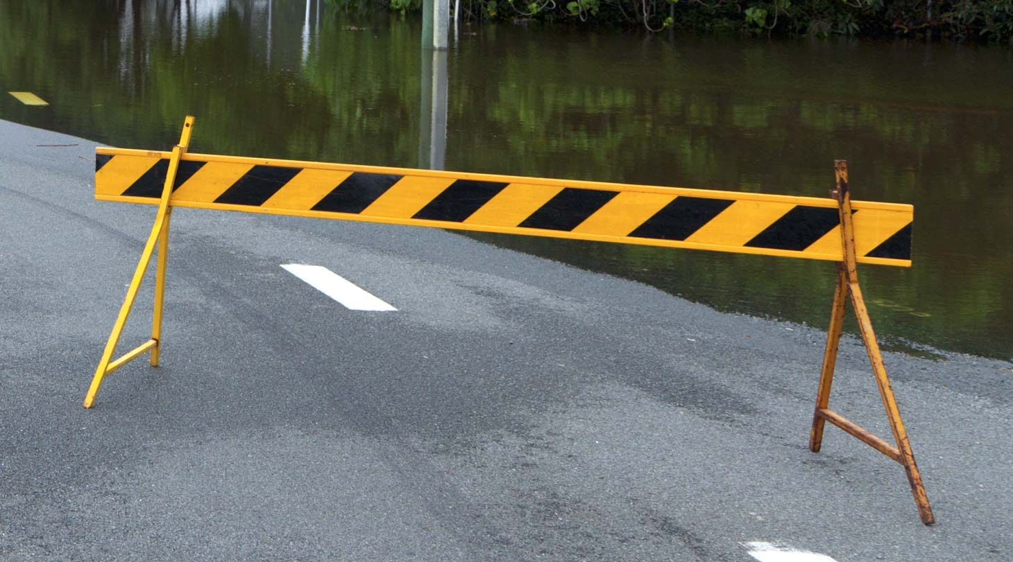 Road safety barrier on flooded road