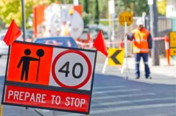 Temporary speed limit and warning signs for roadworks site